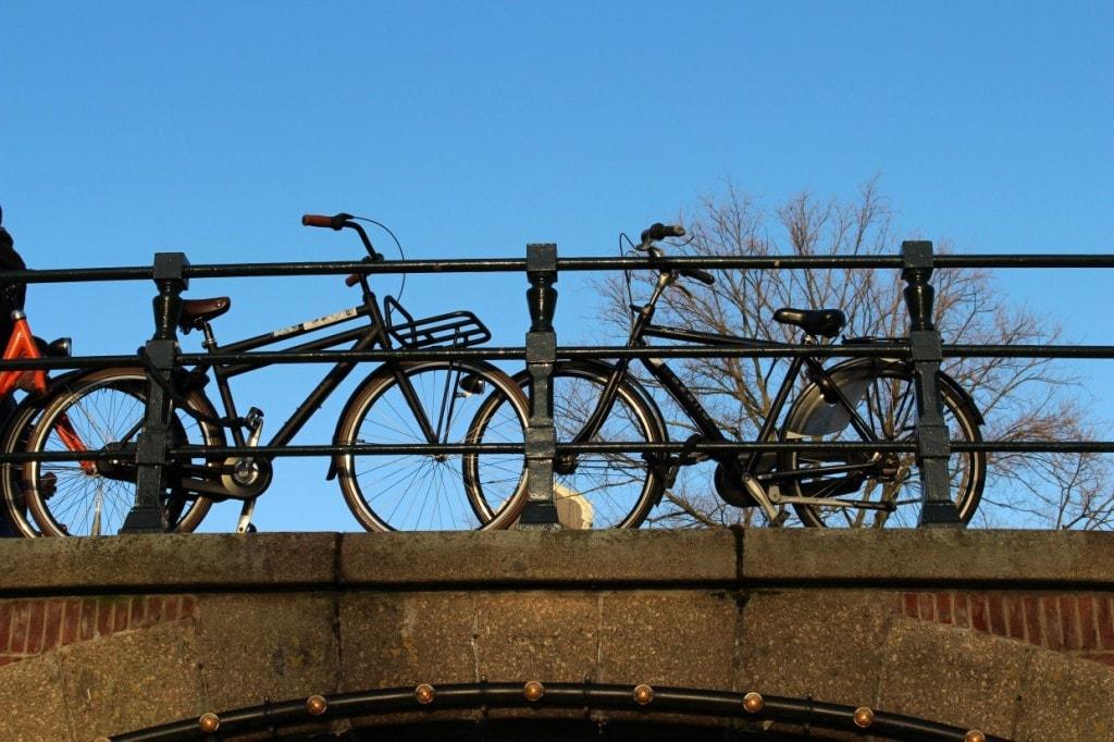 Amsterdam bicycles on top of bridge