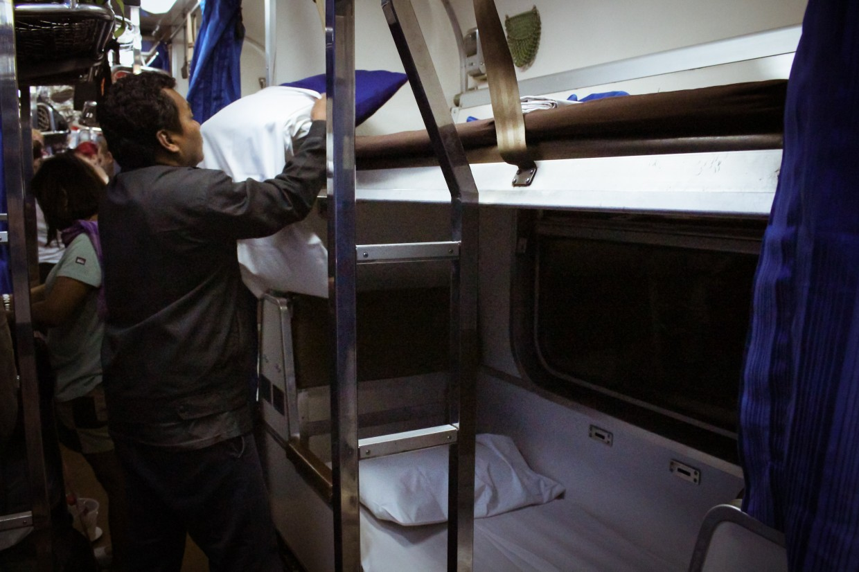Preparing the beds in the Thai sleeper train
