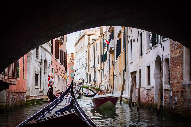 Taking a gondola ride in Venice